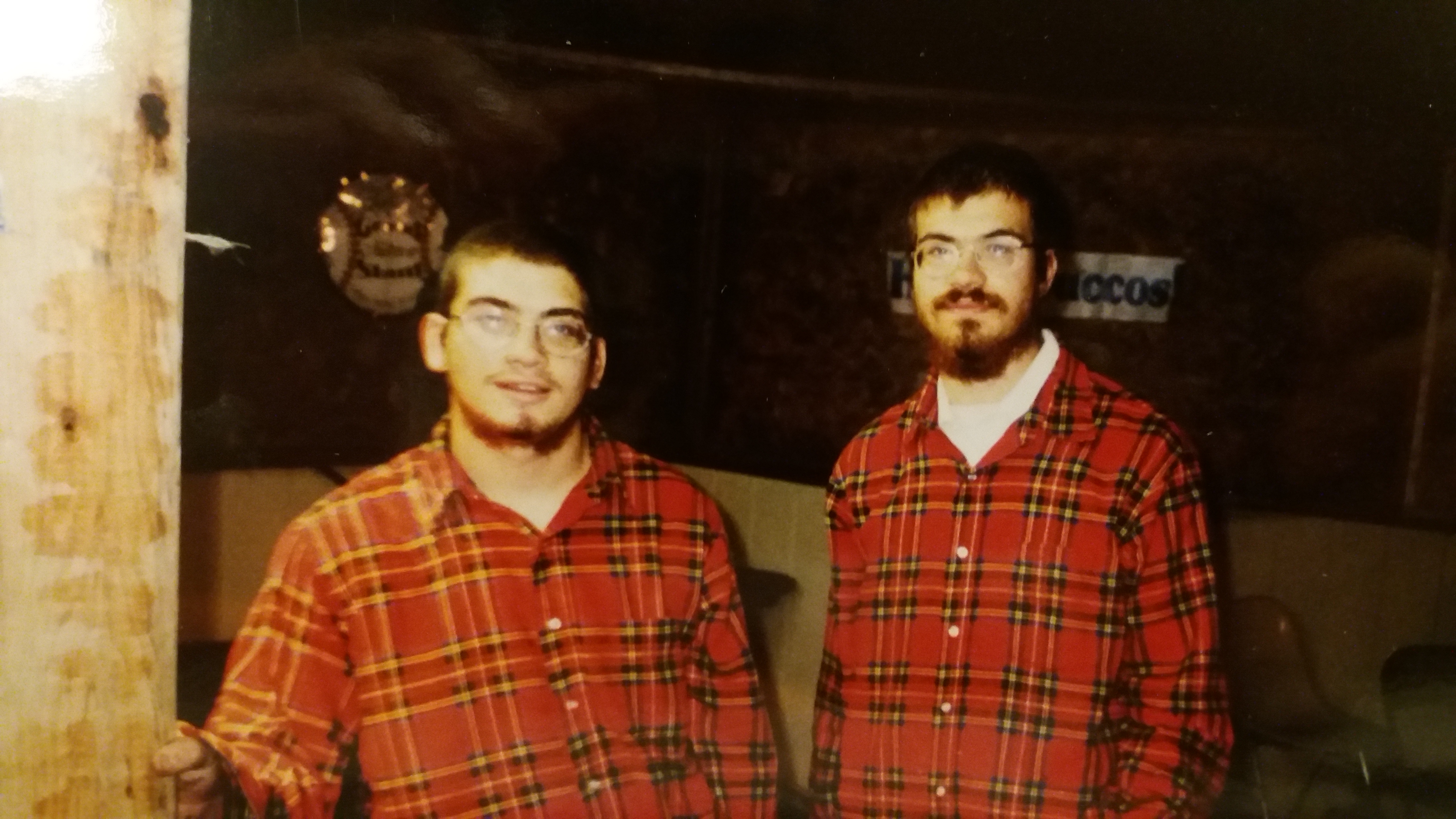 This is a Photo of Rabbi Mendel's brothers Yossi and Shmuly taking down a Sukkah in Flannel Shirts